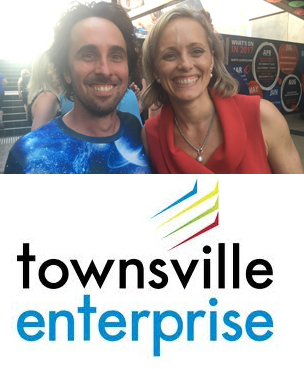 Bridget Woods from Townsville Enterprise celebrating success with Paul from Finn Consulting Australia.